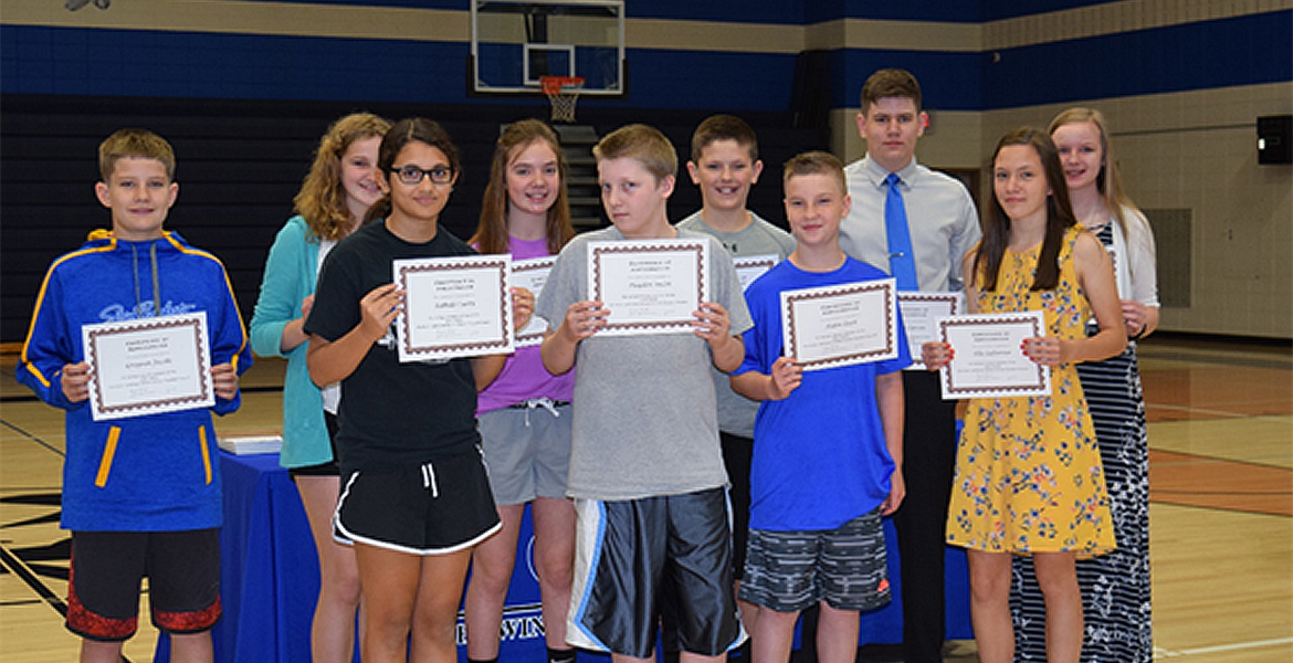 Middle School awards day and students show their awards